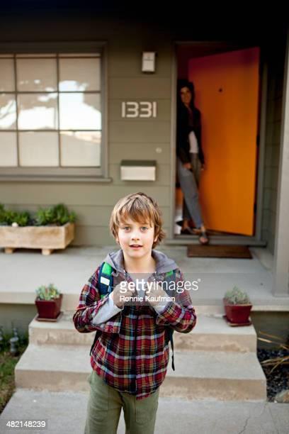 Caucasian boy leaving for school