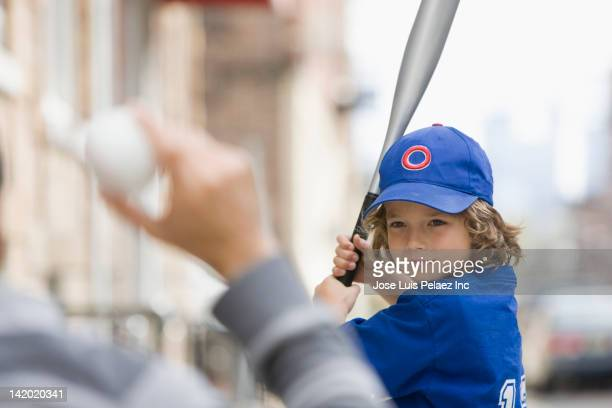 caucasian boy playing baseball with father - batting sports activity stock pictures, royalty-free photos & images