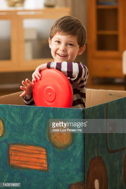 Caucasian boy playing in box