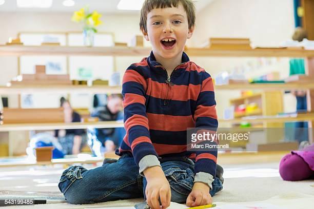 Caucasian boy playing in classroom