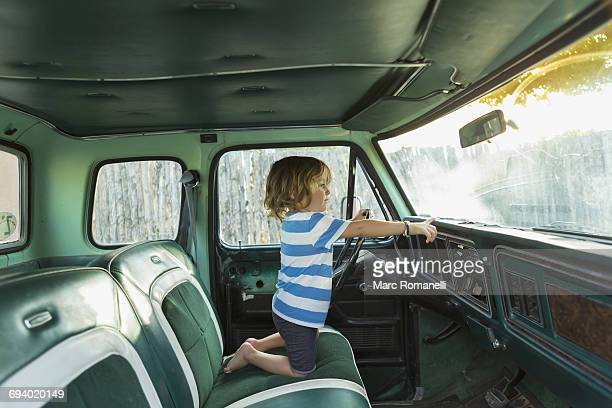 Caucasian boy playing in truck