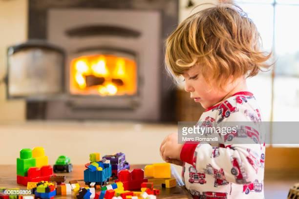 Caucasian boy playing with blocks
