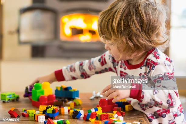 Caucasian boy playing with blocks