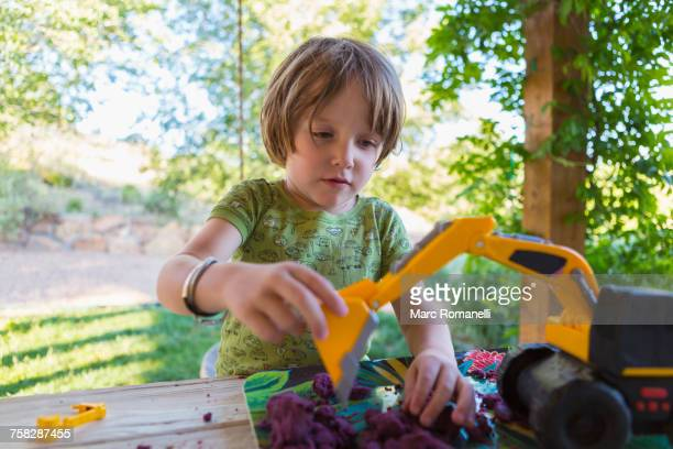 Caucasian boy playing with construction toy