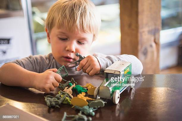 Caucasian boy playing with toys on table