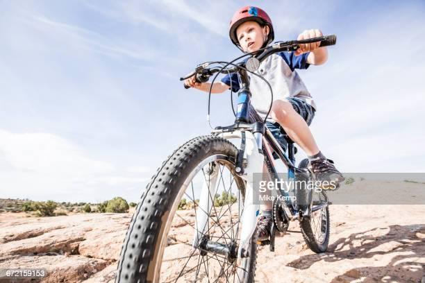 Caucasian boy riding mountain bike