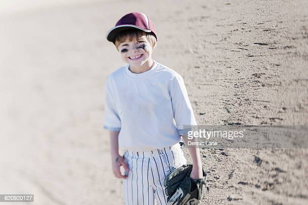 caucasian boy smiling on baseball field - eye black stock photos and pictures