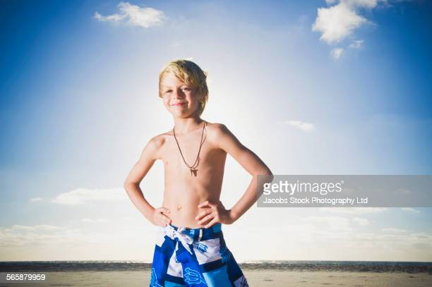 Caucasian boy smiling on beach