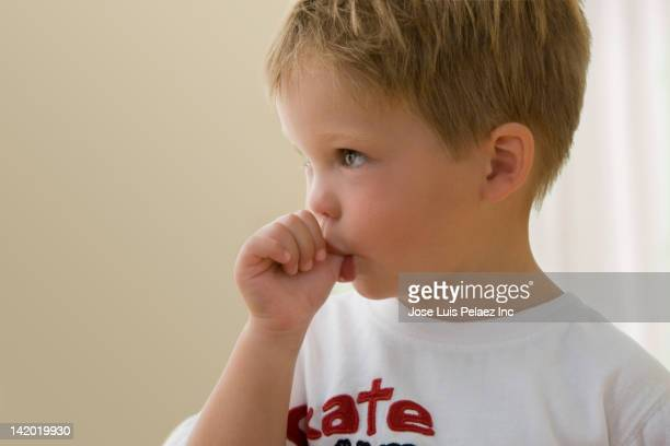 Caucasian boy sucking his thumb
