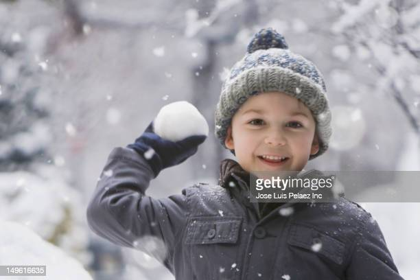 caucasian boy throwing snowball - teasing stock pictures, royalty-free photos & images