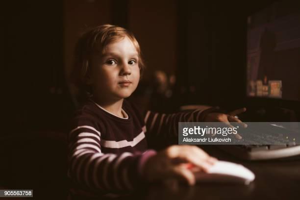 Caucasian boy using computer