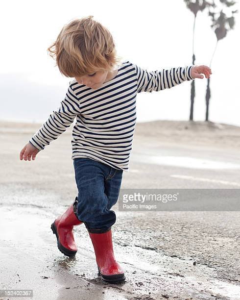 Caucasian boy walking on beach