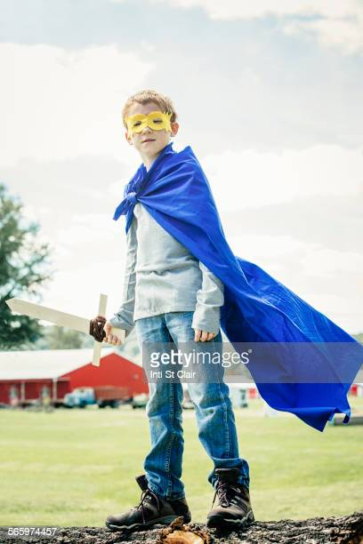 Caucasian boy wearing costume on farm