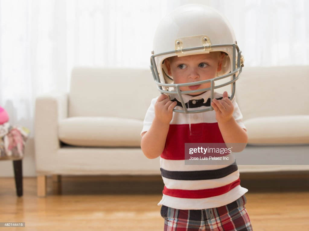 Caucasian boy wearing football helmet : Stock Photo