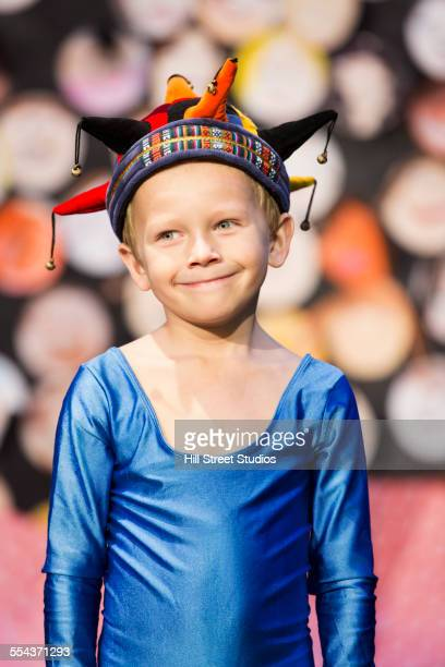 Caucasian boy wearing jester costume
