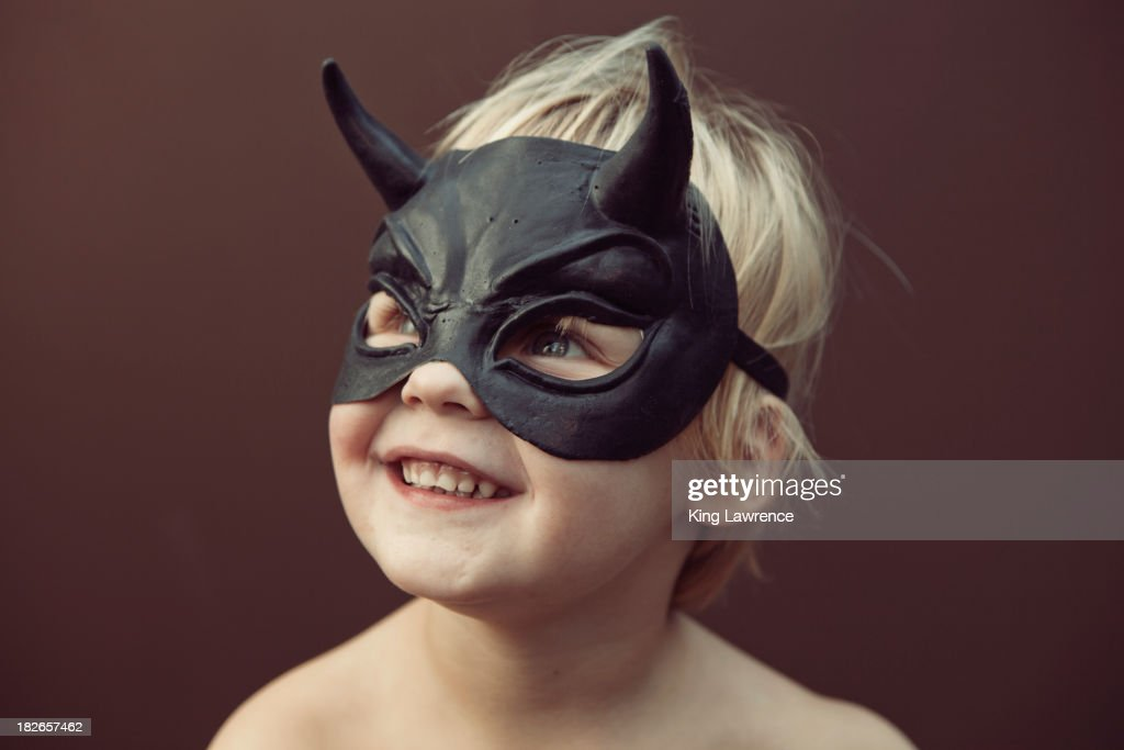 Caucasian boy wearing mask : ストックフォト