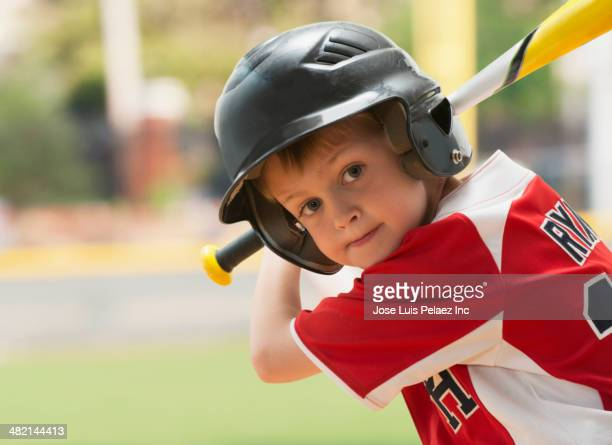 caucasian boy with baseball bat - batting sports activity stock pictures, royalty-free photos & images