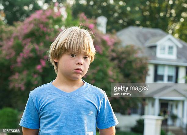 Caucasian boy with Down Syndrome outdoors