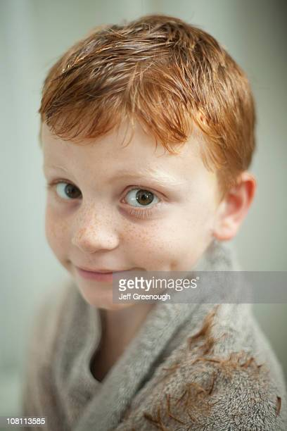 caucasian boy wrapped in towel after haircut - blacksburg stock pictures, royalty-free photos & images