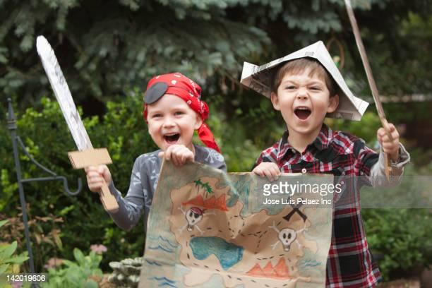 Caucasian boys dressed as pirates