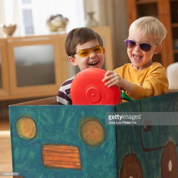 Caucasian boys playing in box