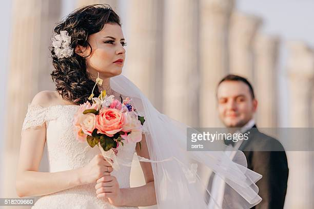 Caucasian bride and groom in wedding dress