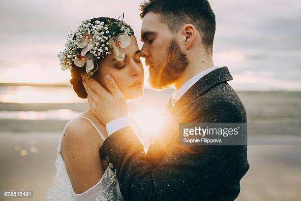 caucasian bride and groom on sunny beach - ceremony stock pictures, royalty-free photos & images