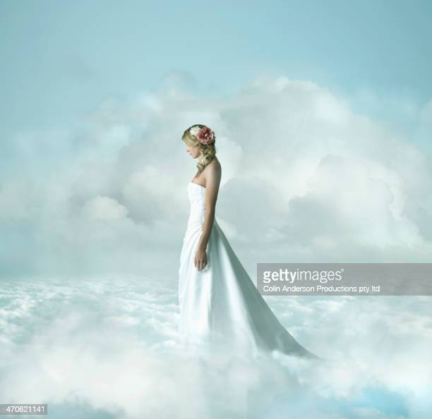 Caucasian bride in clouds