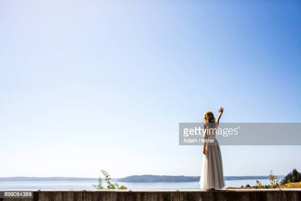 caucasian bride waving near river - evening gown stock pictures, royalty-free photos & images