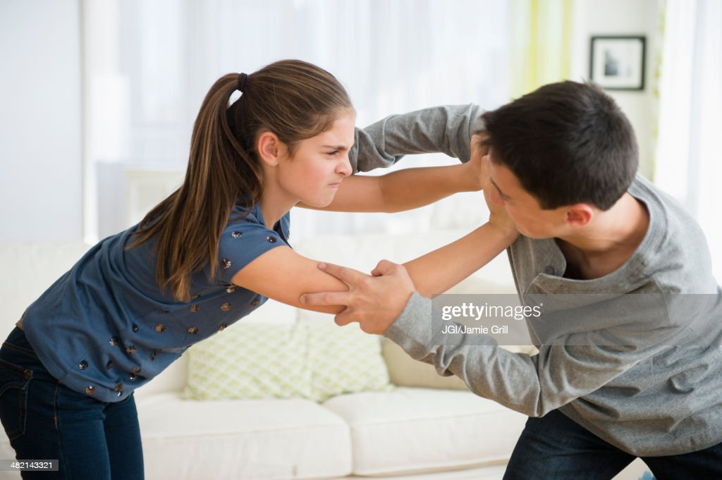 Caucasian brother and sister fighting : ストックフォト