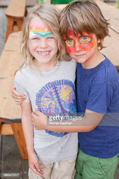 Caucasian brother and sister in face paint