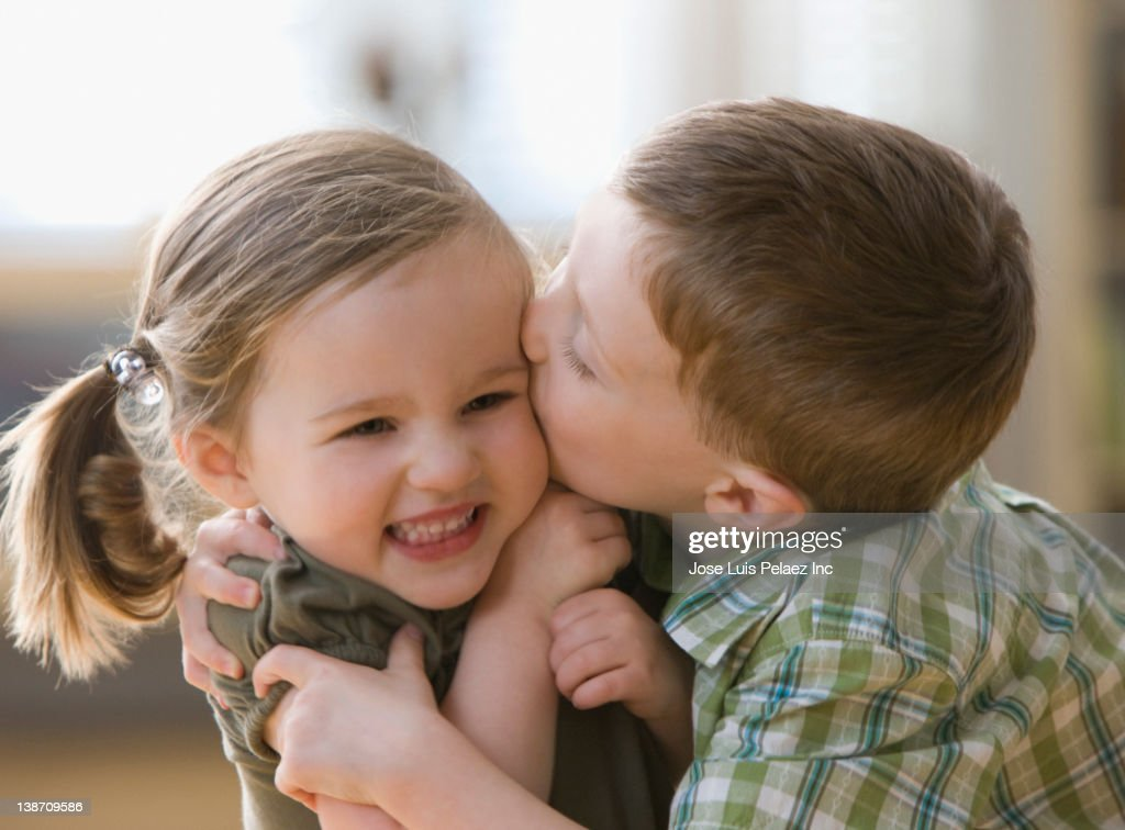 Caucasian brother kissing sister : Stock Photo