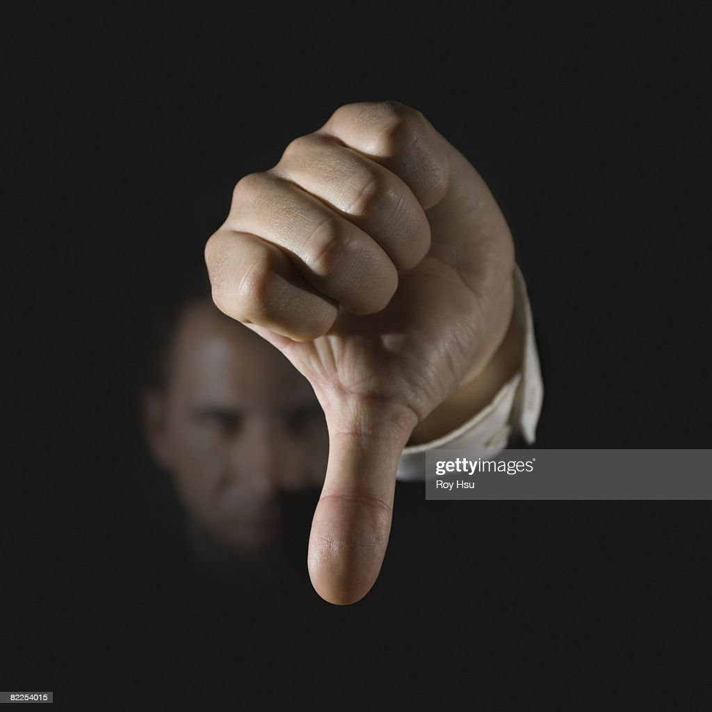 Caucasian business man with thumb down : Stock Photo