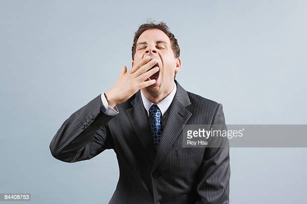 Caucasian business man yawning