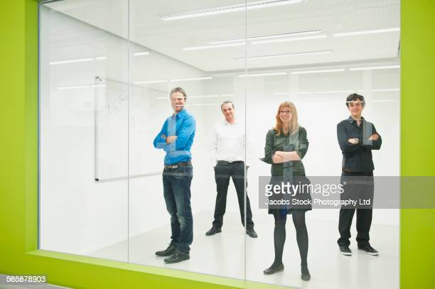 Caucasian business people smiling in office