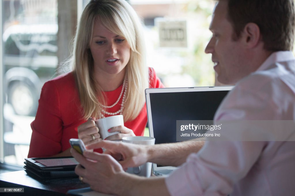Caucasian business people talking in cafe : Stock Photo