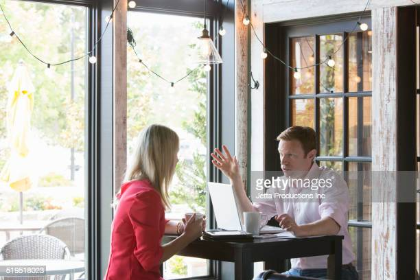 Caucasian business people talking in cafe