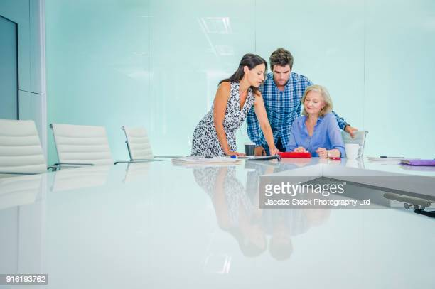 Caucasian business people talking in modern conference room