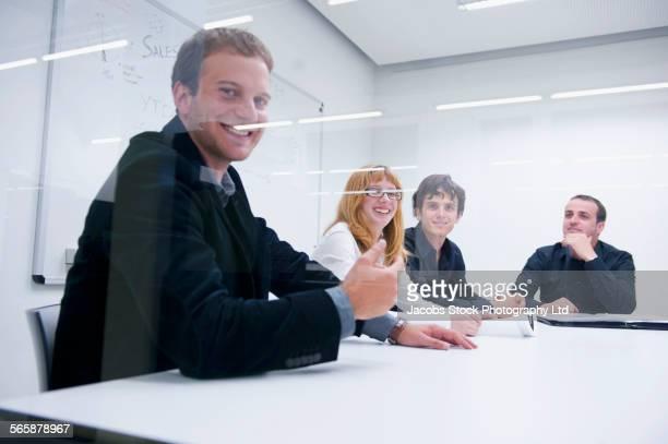 Caucasian business people talking in office meeting