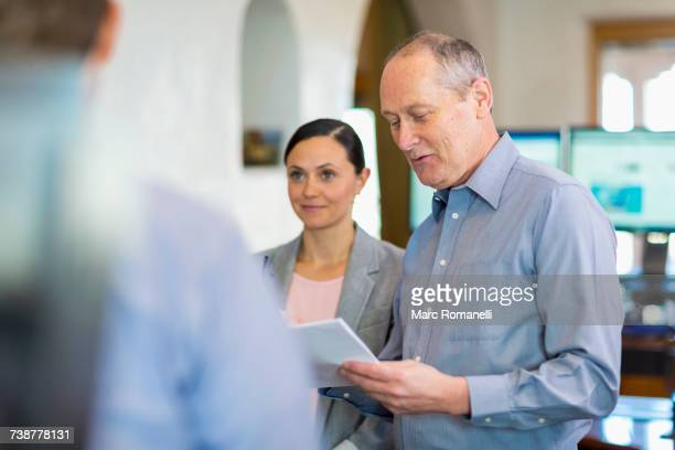 caucasian business people talking in office - mid section stock photos and pictures