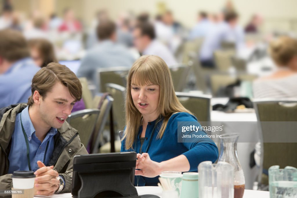 Caucasian business people using digital tablet at conference : Foto stock