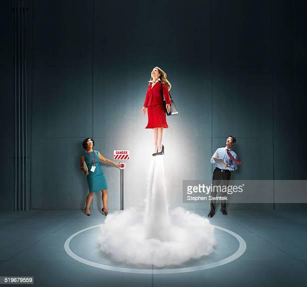 Caucasian business woman blasting off like rocket