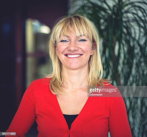 caucasian business woman wearing red - jcbonassin stock pictures, royalty-free photos & images