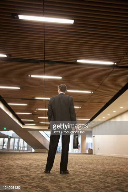 Caucasian businessman carrying briefcase in hotel