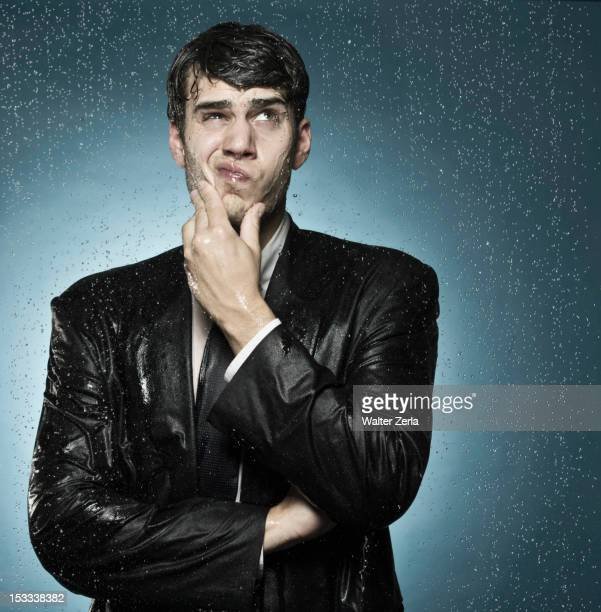 Caucasian businessman caught in the rain