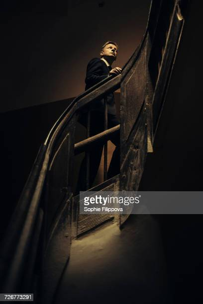 Caucasian businessman climbing staircase