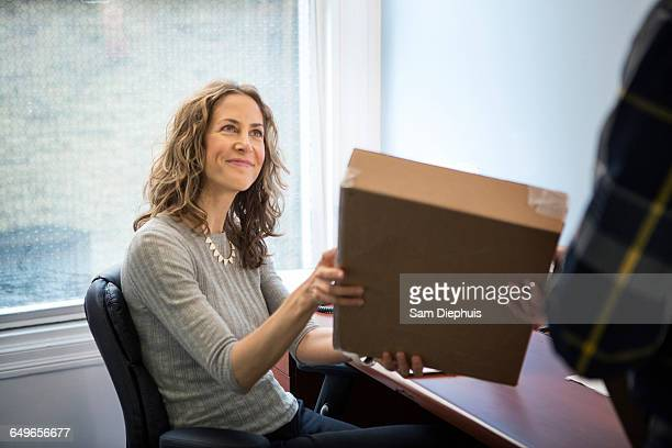 caucasian businessman delivering packages in office - doing a favor stock pictures, royalty-free photos & images