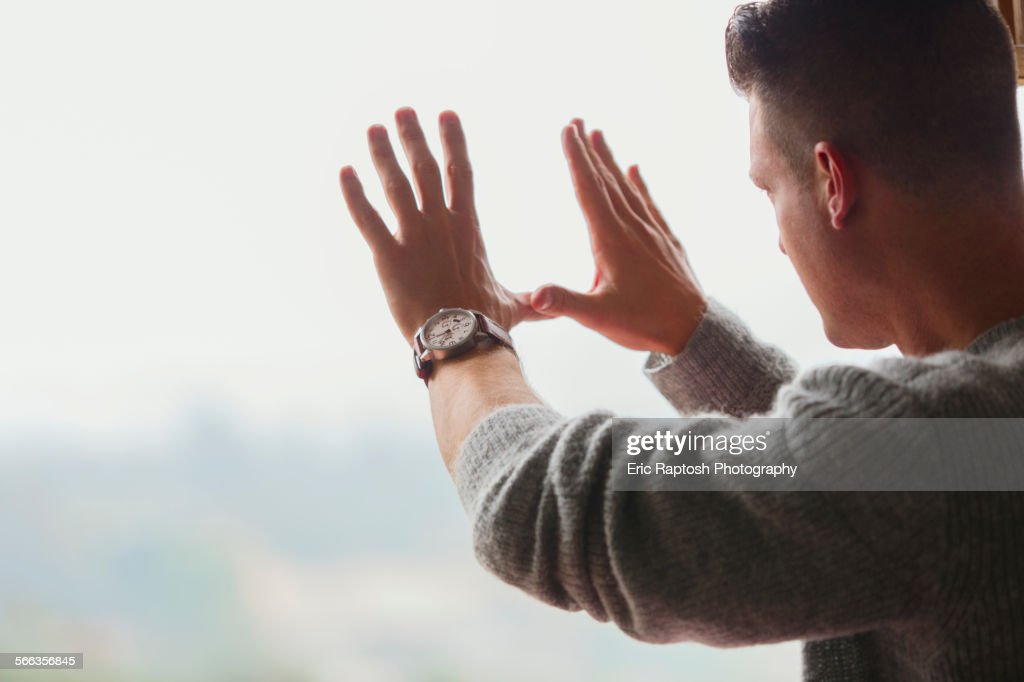 Caucasian businessman framing with hands : Foto de stock