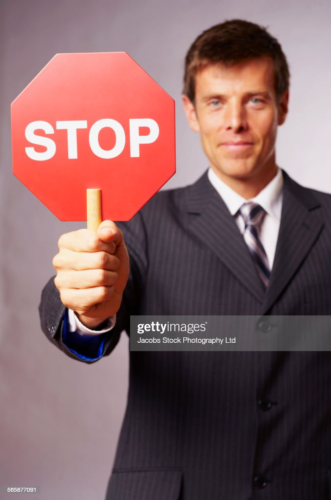 Caucasian businessman holding stop sign : Stock Photo