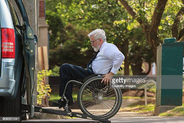 caucasian businessman in wheelchair entering van - disabled access stock photos and pictures